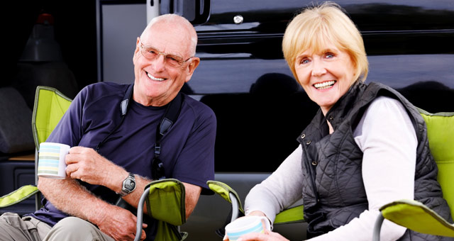 Couple relaxing by their motorhome